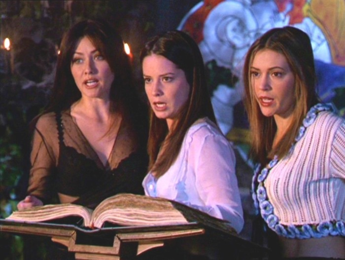 Prue, Piper, and Phoebe using The Book of Shadows