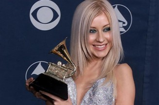 Christina Aguilera at the 2000 Grammy Awards with her Best New Artist Grammy Getty Images