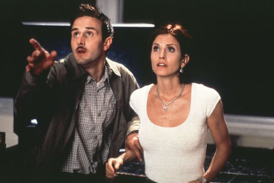 "David Arquette and Courteney Cox as Deputy Dewey and Gale Weathers in ""Scream 2"" Dimension Films"
