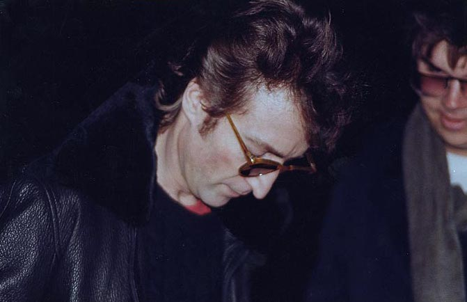 Lennon signing a copy of Double Fantasy for Chapman several hours before the murder. Paul Goresh