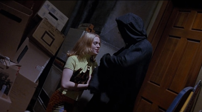 "Tatum Riley (Rose McGowan), sister of Deputy Dewey (David Arquette), encountering Ghostface in ""Scream"" Dimension Films"