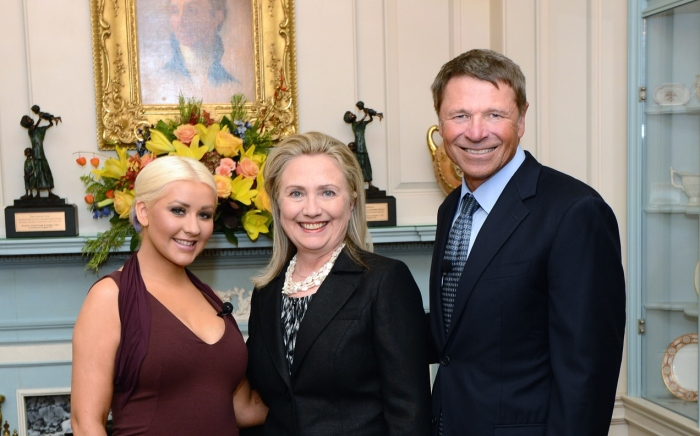 Hillary Clinton and David Novak presenting Christina Aguilera with the George McGovern Leadership Award in October 2012 for her contributions to the United Nations World Hunger Relief effort.  US Department of State