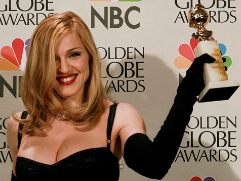 Madonna posing with her Golden Globe AP