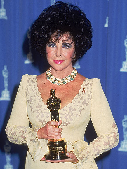 Elizabeth Taylor at the 1992 Academy Awards with her Jean Hersholt Humanitarian Award Getty Images / DMI