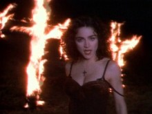 "Madonna dancing in front of burning crosses in her ""Like A Prayer"" music video  Warner Brothers Records"
