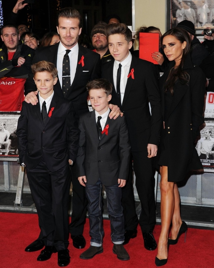 Victoria Beckham, alongside her husband, David Beckham, and their three sons (daughter not shown)