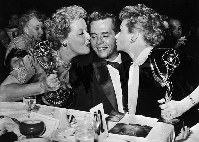 Vivian Vance holding her Emmy for best supporting actress in 1954, while Lucille Ball holding the Emmy