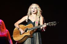 "Taylor Swift performing ""Our Song"" from her debut album in 2007. ""Our Song"" became her first number-one country music hit.  Flickr"